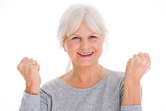 Senior woman clenching fists Royalty Free Stock Photos