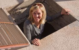 Senior woman climbing out of a hole. Stock Images