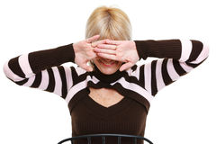 Senior woman closing eyes by hand Royalty Free Stock Photos