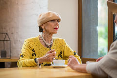 Senior woman and coffee cup. Royalty Free Stock Photography