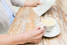 Senior woman with coffee reading newspaper at home Royalty Free Stock Photo