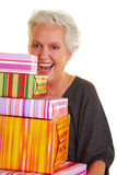 Senior woman with colorful presents Royalty Free Stock Image