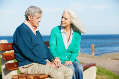 Senior Woman Comforting Depressed Husband Royalty Free Stock Photos