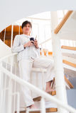Senior Woman Coming Down The Stairs Royalty Free Stock Image
