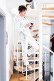 Senior Woman Coming Down The Stairs Stock Image