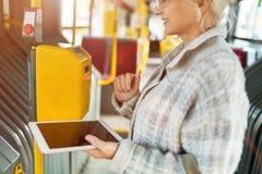 Senior woman validating a ticket royalty free stock photos