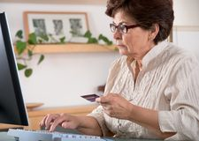Senior woman on computer. Concept may be is shopping in internet Stock Images