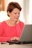 Senior woman with computer Royalty Free Stock Photo
