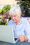 Senior Woman with Computer Royalty Free Stock Photos