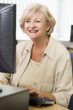 Senior woman on a computer Royalty Free Stock Photos
