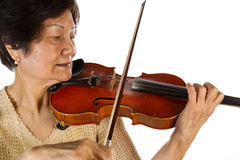Senior woman concentrating while playing the violin Royalty Free Stock Photography