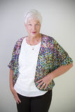 Senior Woman. A senior  confident and mature woman posing for the camera Royalty Free Stock Photo