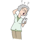 Senior woman confused new phone. An image of a senior woman confused by her new phone Royalty Free Stock Photo