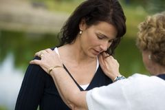 Senior Woman Consoling Her Daughter Stock Images