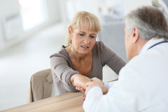 Senior woman consulting specialist. Senior women seeing specialist for diagnostic stock images