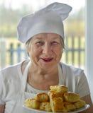 Senior woman cook. The happy senior woman cook Royalty Free Stock Photos