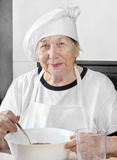 Senior woman cook Royalty Free Stock Images