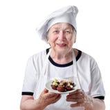 Senior woman cook. Senior smiling happy woman cook Stock Image