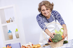 Senior woman cooking Royalty Free Stock Photos