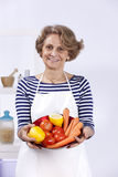 Senior woman cooking Stock Image