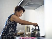 Senior Woman Cooking Food Kitchen Stock Photography