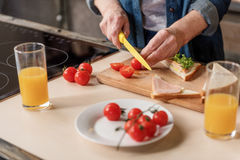 Senior woman cooking healthy breakfast Royalty Free Stock Images