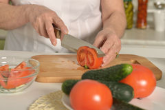 Senior woman cooking in kitchen Stock Image