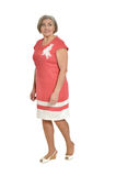 Senior woman in coral dress Royalty Free Stock Photos