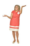 Senior woman in coral dress Royalty Free Stock Photo