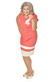Senior woman in coral dress Stock Images