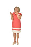 Senior woman in coral dress Stock Image