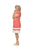 Senior woman in coral dress Royalty Free Stock Image