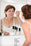 Senior woman and cosmetics Stock Photos