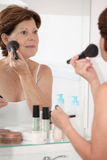 Senior woman and cosmetics Royalty Free Stock Photo