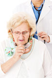 Senior Woman Coughing While Doctor Examining Her Royalty Free Stock Photo