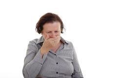A senior woman coughs Stock Photos