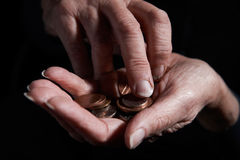 Senior Woman Counting Coins In Hand Stock Photos