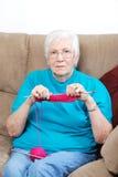 Senior woman counting knitting stitches Royalty Free Stock Photo