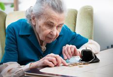 Senior woman counting money Stock Images