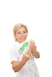 Senior woman counting money over white Stock Image