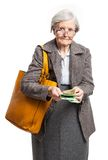 Senior woman counting money over white Royalty Free Stock Photo