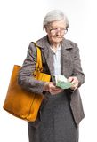 Senior woman counting money Royalty Free Stock Photography