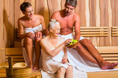 Senior woman and couple in sauna Stock Photos