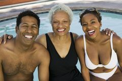 Senior woman and couple at swimming pool portrait. Royalty Free Stock Images