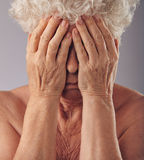 Senior woman covering her face with hands Royalty Free Stock Photo