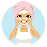 Senior Woman Cream. Happy senior woman applying anti-aging cream on face Royalty Free Stock Photos