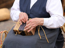 Senior woman while creating a straw bag Stock Photos