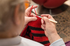 Senior woman with a crochet needle and wool Royalty Free Stock Photo