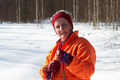 Senior woman cross country skier in forest on sunn Royalty Free Stock Photos