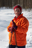 Senior woman cross country skier in forest on sunny day Stock Image